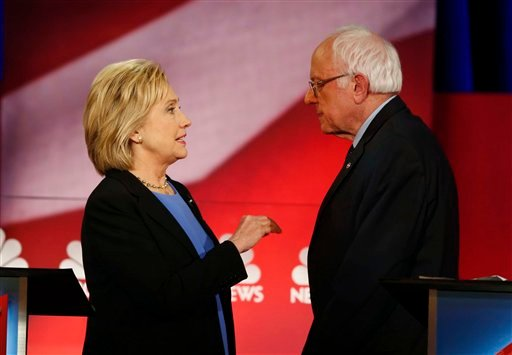 Democratic presidential candidate, Hillary Clinton and Democratic presidential candidate, Sen. Bernie Sanders, I-Vt. speak during a break at the NBC, YouTube Democratic presidential debate at the Gaillard Center, Sunday, Jan. 17, 2016, in Charleston, S.C.