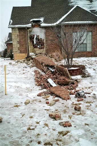 Dec. 29, 2015 photo: Remains of a collapsed chimney rest on the ground outside a home in Edmond, Okla., following an earthquake. In Oklahoma the stronger and more frequent earthquakes have people worrying about the big one.(Doug Hoke/The Oklahoman via AP)