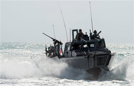 Nov. 2, 2015, image provided by the U.S. Navy, shows Riverine Command Boat (RCB) 805 in the Persian Gulf. Iran was holding 10 U.S. Navy sailors and their two boats, similar to the one in this picture on Jan. 12, 2016. (Torrey W. Lee/U.S. Navy via AP)