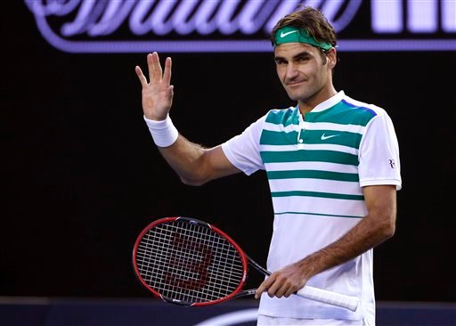 Roger Federer of Switzerland waves after defeating Nikoloz Basilashvili of Georgia during their first round match at the Australian Open tennis championships in Melbourne, Australia, Monday, Jan. 18, 2016.(AP Photo/Vincent Thian)