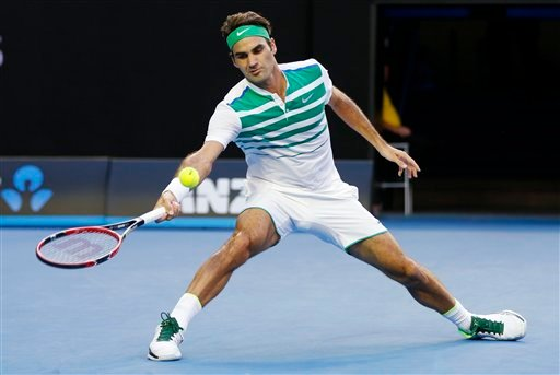 Roger Federer of Switzerland looks to make a forehand return to Nikoloz Basilashvili of Georgia during their first round match at the Australian Open tennis championships in Melbourne, Australia, Monday, Jan. 18, 2016.(AP Photo/Vincent Thian)