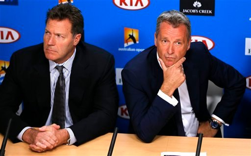 ATP chairman Chris Kermode, right, and vice chairman Mark Young listen to reporter's question during a press conference at the Australian Open tennis championships in Melbourne, Australia, Monday, Jan. 18, 2016. Chairman Kermode and the Tennis Integrity U