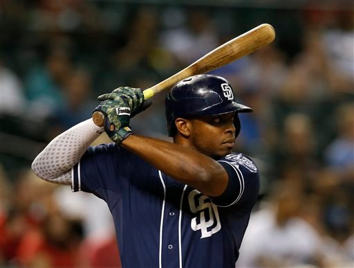 In this Sept. 15, 2015, file photo, San Diego Padres left fielder Justin Upton looks to hit in the sixth inning of a baseball game against the Arizona Diamondbacks in Phoenix.