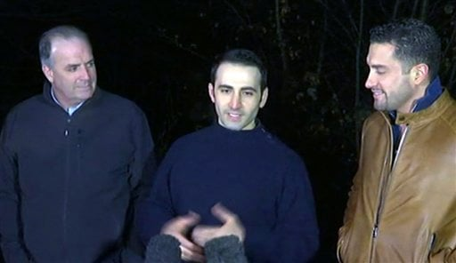 In this image made from video, former U.S Marine Amir Hekmati, center, is flanked by Michigan congressman Dan Kildee, left, and Hekmati's brother-in-law Ramy Kurdi as he speaks to the media in Landstuhl, Germany, Tuesday, Jan. 19, 2016. Former U.S. Marine