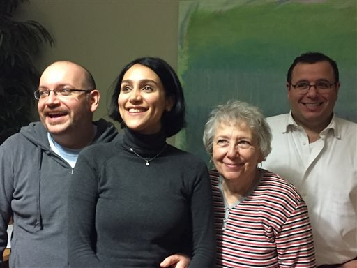 In this photo provided by The Washington Post, from left, Jason Rezaian, his wife Yeganeh Salehi, his mother Mary Rezaian, and brother Ali Rezaian pose for a photo at Landstuhl Regional Medical Center near the Ramstein Air Base, Monday, Jan. 18, 2016 in L
