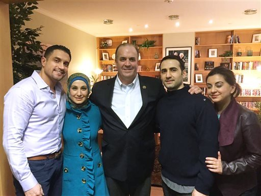 In a Monday, Jan. 18, 2016 photo provided by the Hekmati family, the family and U.S. Rep. Dan Kildee, D-Flint Township, Mich.,meet with former Iran prisoner Amir Hekmati, second from right, at Landstuhl Regional Medical Center in Landstuhl, Germany. From