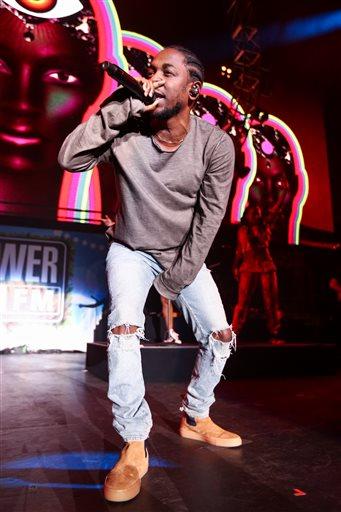 FILE - In this Dec. 4, 2015, file photo, Kendrick Lamar performs at Power 106's Cali Christmas 2015 in Inglewood, Calif.