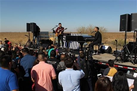 The artists performed in front of some 250 people in protest against massive migrant deportations as part of the Legends' campaign #FREEAMERICA. (AP Photo/Ricardo Arduengo)