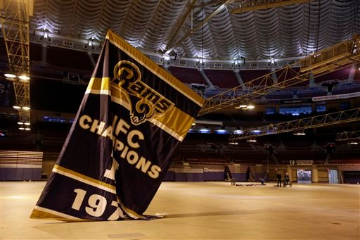 Championship banners are removed from the ceiling of the Edward Jones Dome, former home of the St. Louis Rams football team, Thursday, Jan. 14, 2016, in St. Louis.
