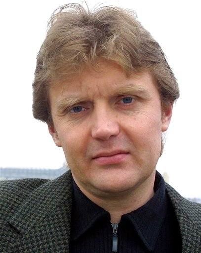 FILE - In this Friday, May 10, 2002 file photo Alexander Litvinenko, former KGB spy is photographed at his home in London.