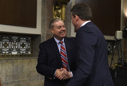 Senate Armed Services Committee member Sen. Lindsey Graham, R-S.C., left, shakes hands with Army Secretary nominee Eric Fanning on Capitol Hill in Washington, Thursday, Jan. 21, 2016, after Fanning testified before the committee's hearing on his nominatio