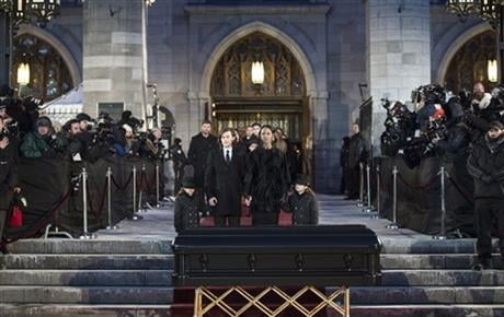 Celine Dion leaves the church with her children, Rene-Charles, center left, and twins Eddy and Nelson after funeral services for her husband Rene Angelil, at Notre Dame Basilica Friday, Jan. 22, 2016 in Montreal. Angelil died Jan. 14, in Las Vegas. AP