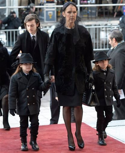 Singer Celine Dion arrives with sons Eddy and Nelson for the funeral for her husband Rene Angelil at Notre-Dame Basilica, Friday, Jan. 22, 2016, in Montreal. Angelil died on Jan. 14, in Las Vegas at the age of 73. (Ryan Remiorz/The Canadian Press via AP)