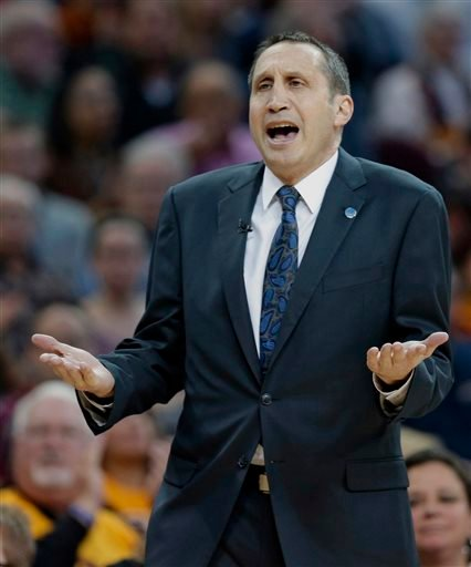 Cleveland Cavaliers head coach David Blatt argues with an official in the first half of an NBA basketball game against the Los Angeles Clippers, Thursday, Jan. 21, 2016, in Cleveland.