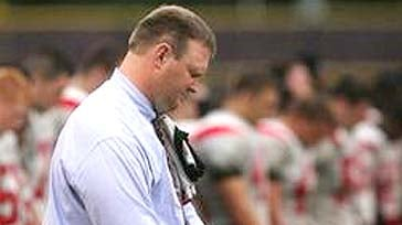 Louisville Pleasure Ridge Park football coach David Jason Stinson is seen on the sidelines during the team's first game back after Max Gilpin's death in this Sept. 26, 2008 photo in Louisville, Ky. Pleasure Ridge sophomore Max Gilpin collapsed on Aug. 20,