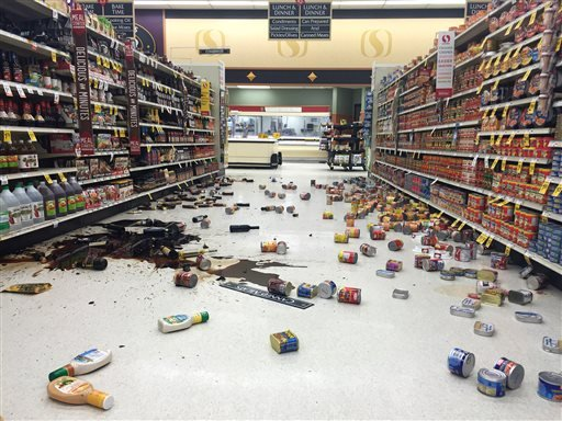 In this photo provided by Vincent Nusunginya, items fallen from the shelves litter the aisles inside a Safeway grocery store following a magnitude 6.8 earthquake on the Kenai Peninsula on Sunday Jan. 24, 2016, in south-central Alaska. The quake knocked it