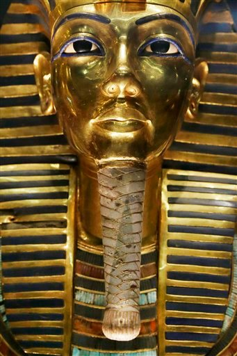 In this Saturday, Jan. 24, 2015 file photo, The gold mask of King Tutankhamun is seen in a glass case during a press tour, in the Egyptian Museum near Tahrir Square, Cairo. Egyptian prosecutors have referred to trial eight restorers involved in the botche