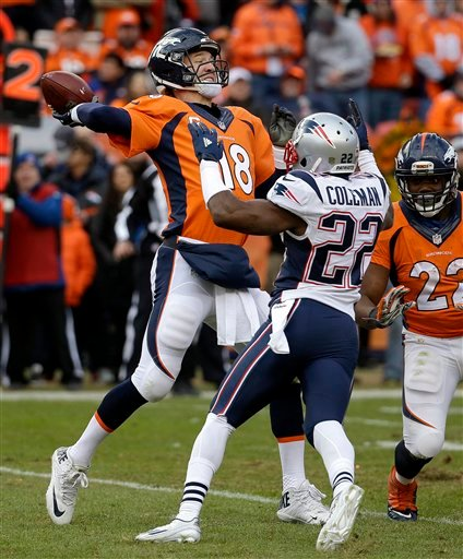 Denver Broncos quarterback Peyton Manning passes while being defended by New England Patriots cornerback Justin Coleman (22) during the second half of the NFL football AFC Championship game between the Denver Broncos and the New England Patriots, Sunday,