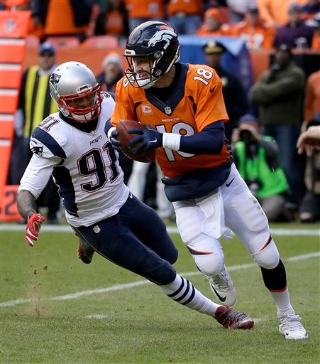 Denver Broncos quarterback Peyton Manning evades a tackle by New England Patriots outside linebacker Jamie Collins (91) during the first half of the NFL football AFC Championship game between the Denver Broncos and the New England Patriots, Sunday, Jan. 2