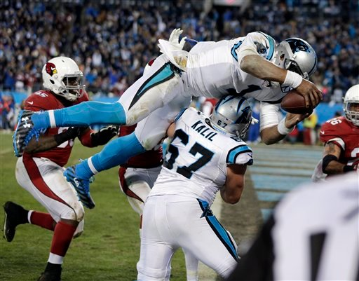 Carolina Panthers' Cam Newton leaps in the end zone for a touchdown run during the second half the NFL football NFC Championship game against the Arizona Cardinals, Sunday, Jan. 24, 2016, in Charlotte, N.C. (AP Photo/Chuck Burton)