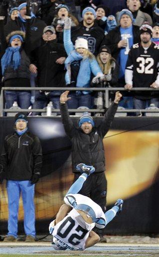 Carolina Panthers' Kurt Coleman intercepts a pass during the first half the NFL football NFC Championship game against the Arizona Cardinals, Sunday, Jan. 24, 2016, in Charlotte, N.C. (AP Photo/Chuck Burton)