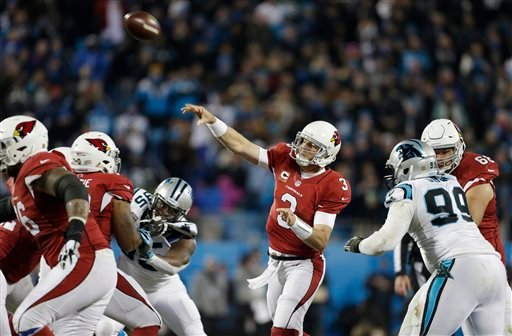 Arizona Cardinals' Carson Palmer throws during the first half the NFL football NFC Championship game against the Carolina Panthers, Sunday, Jan. 24, 2016, in Charlotte, N.C. (AP Photo/Bob Leverone)