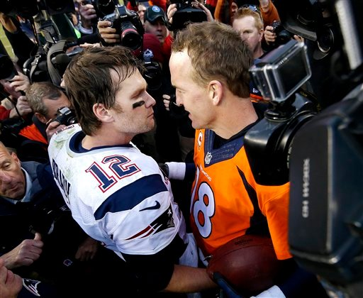 New England Patriots quarterback Tom Brady and Denver Broncos quarterback Peyton Manning speak to one another following the NFL football AFC Championship game Sunday, Jan. 24, 2016, in Denver. (AP Photo/David Zalubowski)
