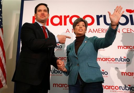 Sen. Joni Ernst, R-Iowa, right, introduces Republican presidential candidate, Sen. Marco Rubio, R-Fla. before he spoke at a campaign event, Monday, Jan. 25, 2016 in Des Moines, Iowa. (AP Photo/Paul Sancya)