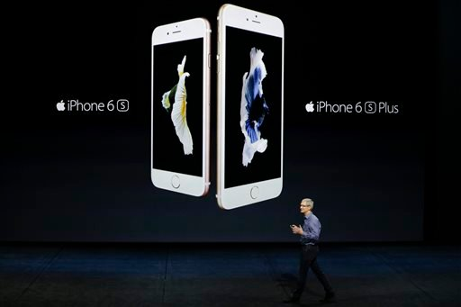 In this Wednesday, Sept. 9, 2015, file photo, Apple CEO Tim Cook discusses the new iPhone 6s and iPhone 6s Plus during the Apple event at the Bill Graham Civic Auditorium in San Francisco. Most analysts believe Apple surpassed its own record by selling mo