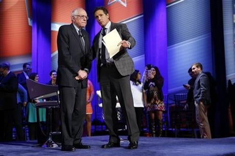 Democratic presidential candidate, Sen. Bernie Sanders, I-Vt.,, left, speaks with host Chris Cuomo during a commercial break during a CNN town hall at Drake University in Des Moines, Iowa, Monday, Jan. 25, 2016. (AP Photo/Patrick Semansky)