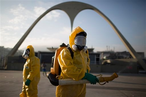 A health worker stands in the Sambadrome as he sprays insecticide to combat the Aedes aegypti mosquitoes that transmits the Zika virus in Rio de Janeiro, Brazil, Tuesday, Jan. 26, 2016. Inspectors begin to spray insecticide around Sambadrome, the outdoor