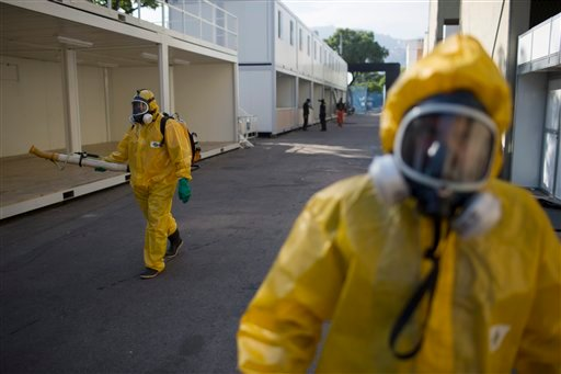 A health worker sprays insecticide to combat the Aedes aegypti mosquitoes that transmits the Zika virus at the Sambadrome in Rio de Janeiro, Brazil, Tuesday, Jan. 26, 2016. Inspectors begin to spray insecticide around Sambadrome, the outdoor grounds where