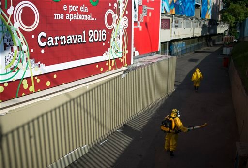 A health worker sprays insecticide to combat the Aedes aegypti mosquitoes that transmits the Zika virus under the bleachers of the Sambadrome in Rio de Janeiro, Brazil, Tuesday, Jan. 26, 2016. Inspectors begin to spray insecticide around Sambadrome, the o