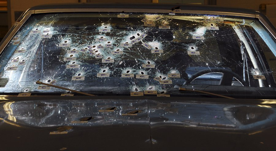 In this Nov. 30, 2012, file forensics photo released by the Office of the Ohio Attorney General, bullet holes are visible on the windshield and hood of a Chevy Malibu peppered by gunshots after a high-speed chase that ended in the deaths of two unarmed su