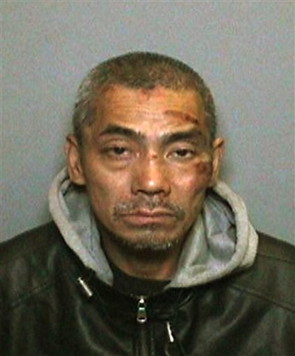 This undated booking photo provided by the Orange County, Calif., Sheriff's Department on Saturday, Jan. 23, 2016, shows 43-year-old Bac Duong, one of three jail inmates charged with violent crimes, who escaped from the Central Men's Jail in Santa Ana, Ca