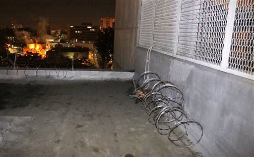 This Jan. 23, 2016 photo provided by the Orange County Sheriff's Office shows the exterior of Central Men's Jail in Santa Ana, Calif., showing where razor wire was removed from a parapet, center rear, and a rope-like line, seen at right, which authorities