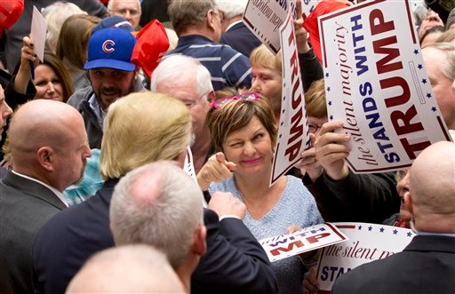 A support winks at Republican presidential candidate Donald Trump after he signed an autograph for her during a campaign event at the Roundhouse Gymnasium, Tuesday, Jan. 26, 2016, in Marshalltown, Iowa. (AP Photo/Mary Altaffer)