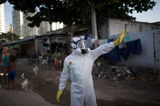A municipal worker gestures during an operation to combat the Aedes aegypti mosquitoes that transmits the Zika virus in Recife, Pernambuco state, Brazil, Tuesday, Jan. 26, 2016. Brazil's health minister Marcelo Castro says the country is sending some 220,