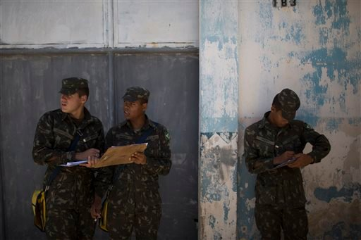 Brazilian Army soldiers take notes as they inspects homes during an operation to combat the Aedes aegypti mosquitoes that transmits the Zika virus in Recife, Pernambuco state, Brazil, Tuesday, Jan. 26, 2016. Brazil's health minister Marcelo Castro said th