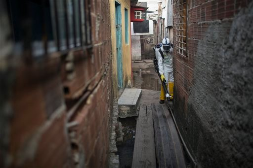 A municipal worker sprays insecticide to combat the Aedes aegypti mosquitoes that transmits the Zika virus at the Imbiribeira neighborhood in Recife, Pernambuco state, Brazil, Tuesday, Jan. 26, 2016. Brazil's health minister Marcelo Castro said that nearl