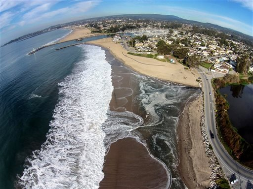 This January 20, 2015 photo provided by The Nature Conservancy shows Twin Lakes Beach in Santa Cruz, Calif. and Schwann Lagoon, the body of water on the right. The Nature Conservancy an environmental group in California is recruiting drone hobbyists to ma