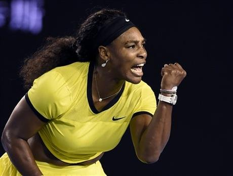 Serena Williams of the United States celebrates after winning a point against Agnieszka Radwanska of Poland during their semifinal match at the Australian Open tennis championships in Melbourne, Australia, Thursday. (AP Photo/Andrew Brownbill)