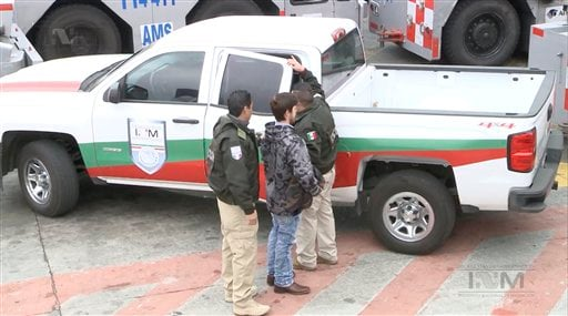 This frame grab taken from a Thursday, Jan. 28, 2016 video provided by Mexico's Instituto Nacional de Migracion, INM, shows Ethan Couch, as he is escorted by Mexican immigration agents, upon their arrival to the international airport in Mexico City. INM s