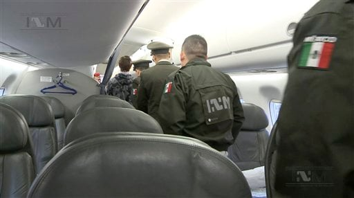 This frame grab taken from a Thursday, Jan. 28, 2016 video provided by Mexico's Instituto Nacional de Migracion, INM, shows Ethan Couch, escorted onto a plane by Mexican immigration agents, in Mexico City. INM says it has taken the Texas teenager who used