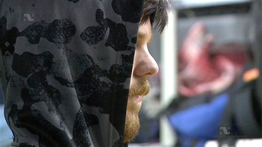 """This frame grab from a Thursday, Jan. 28, 2016 taken from a video provided by Mexico's Instituto Nacional de Migracion, INM, shows a hooded Ethan Couch, as he is processed by Mexican immigration agents, in Mexico City. INM said that Couch, who used an """"af"""