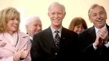 """Chesley """"Sully"""" Sullenberger, the US Airways pilot who landed in New York's Hudson River with all onboard escaping safely, smiles during a homecoming celebration on Saturday, Jan. 24, 2009, in Danville, Calif. Applauding him are his wife Lorrie Sullenberg"""