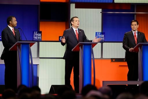 Republican presidential candidate Sen. Ted Cruz, R-Texas, center, answers a question as retired neurosurgeon Ben Carson, left, and Sen. Marco Rubio, R-Fla., right, listen during a Republican presidential primary debate.