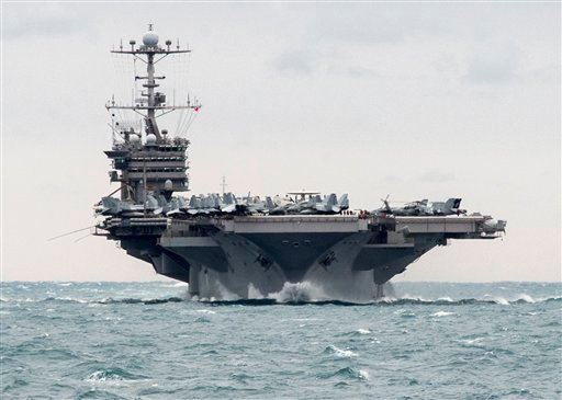 In this Saturday, Dec. 26, 2015 photo released by the U.S. Navy, the aircraft carrier USS Harry S. Truman transits the Strait of Hormuz.