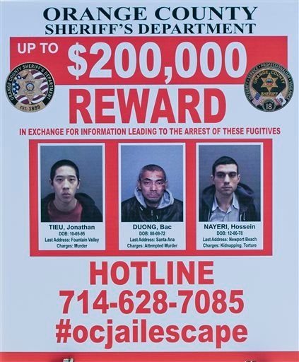 A wanted sign is displayed for the The reward for information leading to the arrest of the the three escaped inmates from the Orange County Central Men's Jail on Tuesday, Jan. 26, 2016, in Santa Ana, Calif.