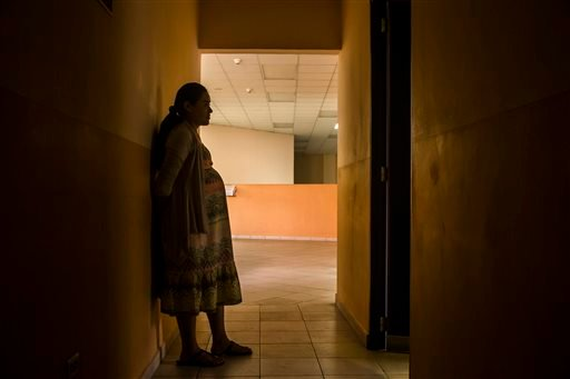 In this Jan. 29, 2016 photo, Carmen Cruz, 31, waits to have her prenatal exam at the National Hospital for Women in San Salvador, El Salvador. Latin American governments are preparing as Zika, mosquito-borne illness, spreads through the continent. In the